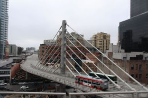 View of Transbay Bus Bridge as AC Transit and MUNI bus pass each other